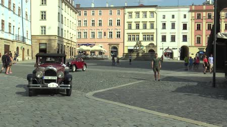 their : OLOMOUC, CZECH REPUBLIC, JULY 5, 2018: Historic cars veterans on a public car ride through city of Olomouc drive people, first arriving of Chrysler 58 1925 and Aero 662 1930, Czech, Europe