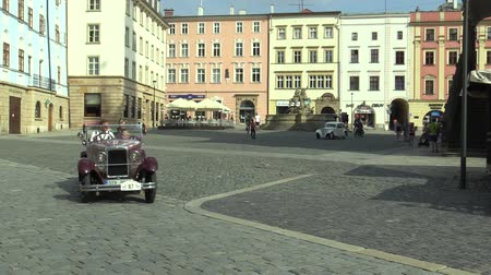their : OLOMOUC, CZECH REPUBLIC, JULY 5, 2018: Historic cars veterans on a public car ride through city of Olomouc drive people, first arriving Zbrojovka Brno Z 9, Z 4 III and motorcycle JAWA 175 Special 1938
