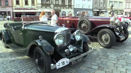 drive through : OLOMOUC, CZECH REPUBLIC, JULY 5, 2018: Historic cars veterans on a public car ride through city of Olomouc drive people, first arriving of Bentley Tourer 1938, and Bugatti 57 1934