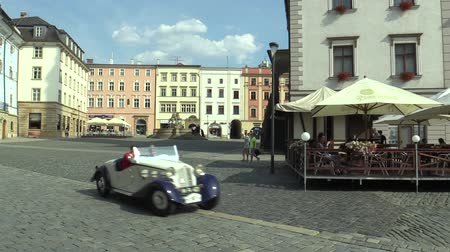 their : OLOMOUC, CZECH REPUBLIC, JULY 5, 2018: Historic cars veterans on a public car ride through city of Olomouc drive people, first arriving of Zbrojovka Brno Z 4 Roadster