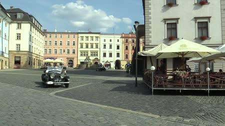 motorcar : OLOMOUC, CZECH REPUBLIC, JULY 5, 2018: Historic cars veterans on a public car ride through city of Olomouc drive people, first arriving of Bentley Tourer 1938, Tatra 75 1936 and Triumph Gloria 1935