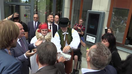 richard : OLOMOUC, CZECH REPUBLIC, MAY 15 , 2018: Czech Prime Minister Andrej Babis comes in Olomouc Region, man and woman in traditional Hana costume, welcomed bread with salt and alcohol plum liquor slivovitz