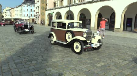 valued : OLOMOUC, CZECH REPUBLIC, JULY 5, 2018: Historic cars veterans on a public car ride through city of Olomouc drive people, first arriving of Walter Junior 1932 and Essex Super Six 1925, Europe