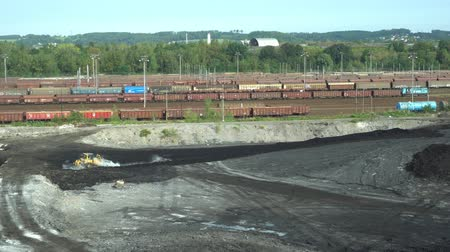 meio : OSTRAVA, CZECH REPUBLIC, AUGUST 28, 2018: Liquidation of remediation of landfills waste of oil and toxic substances, burnt lime is applied to the oil pollution by means of fine cutter bulldozer 4K