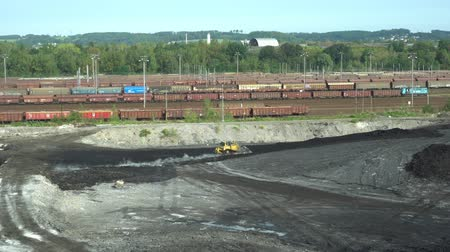 buldozer : OSTRAVA, CZECH REPUBLIC, AUGUST 28, 2018: Liquidation of remediation of landfills waste of oil and toxic substances, burnt lime is applied to the oil pollution by means of fine cutter bulldozer 4K