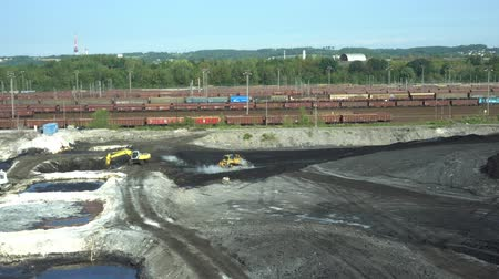 buldozer : OSTRAVA, CZECH REPUBLIC, AUGUST 28, 2018: Liquidation of remediation of landfills waste of oil and toxic substances, burnt lime is applied to oil pollution by means of fine cutter excavator bulldozer