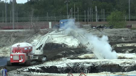 poisoned : OSTRAVA, CZECH REPUBLIC, AUGUST 28, 2018: Liquidation of remediation of landfills waste of oil and toxic substances, burnt lime is applied to the oil pollution by means of a fine cutter excavator