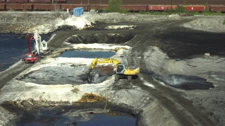 buldozer : OSTRAVA, CZECH REPUBLIC, AUGUST 28, 2018: Liquidation of remediation of landfills waste of oil and toxic substances, burnt lime is applied to oil pollution by means of fine cutter excavator