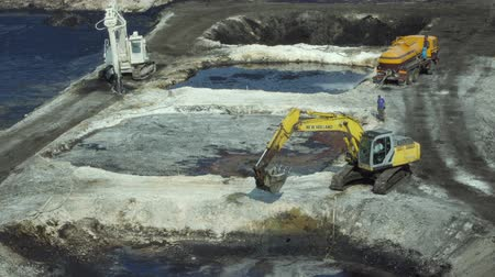 čeština : OSTRAVA, CZECH REPUBLIC, AUGUST 28, 2018: Liquidation of remediation of landfills waste of oil and toxic substances, digger prepares oil pollution sludge for remediation