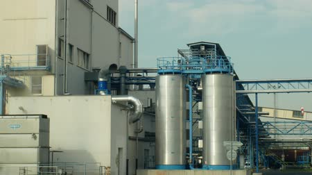 çiftçilik : OLOMOUC, CZECH REPUBLIC, OCTOBER 24, 2018: Factory storage towers for oilseed rape. For the production of vegetable seed oils, biofuels and biodiesel. Commercial agriculture, Europe