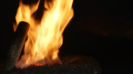burn out : Pellet fire burn with spruce sawdust into the delivery strew bio wooden pallets to industrial modern boiler, sparks fly out and flames fire detail , biofuels made from compressed biomass fuel