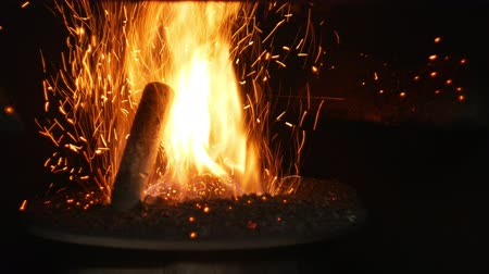 compressed : Pellets fire burn with spruce sawdust into the delivery strew bio wooden pallets to industrial modern boiler, sparks fly out and flames fire detail , biofuels made from compressed biomass fuel