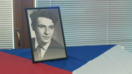 oppression : OLOMOUC, CZECH REPUBLIC, JANUARY 16, 2019: Jan Palach portrait student and flag Czech Republic, city hall room and historic buildings in Olomouc, 50 years anniversary, memorial, 1968 occupation Stock Footage