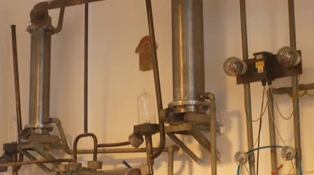 kvaš : OLOMOUC, CZECH REPUBLIC, SEPTEMBER 30, 2018: Growing distillery for the production of plum brandy by firing in a gas boiler, bottles plum liquor slivovitz, simple manufacturing system burning