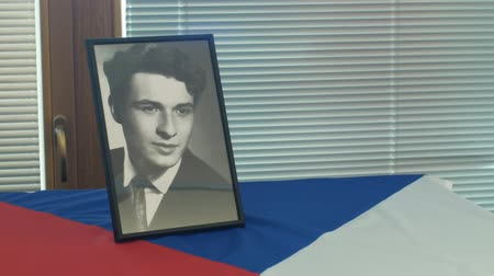 namesti : OLOMOUC, CZECH REPUBLIC, JANUARY 16, 2019: Jan Palach portrait student and flag Czech Republic, city hall room and historic buildings in Olomouc, 50 years anniversary, memorial, 1968 occupation Stock Footage