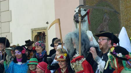 associated : OLOMOUC, CZECH REPUBLIC, FEBRUARY 29, 2019: Carnival Masopust celebration masks parade festival near city hall, traditional Slavic ethnic celebration, winter associated with folk costumes mask Stock Footage
