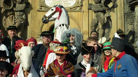 associated : OLOMOUC, CZECH REPUBLIC, FEBRUARY 29, 2019: Carnival Masopust celebration masks festival heritage plague column, traditional Slavic ethnic celebration, winter associated with folk costumes mask