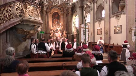 choral : OLOMOUC, CZECH REPUBLIC, APRIL 15, 2018: Most Holy of the Body and Blood of the Christ the Peoples Body is feast of Catholic Church, choral singing people traditional folk costume of Hana