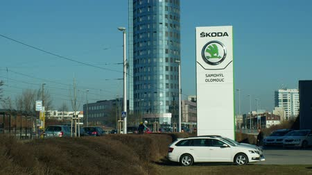 blue skoda : OLOMOUC, CZECH REPUBLIC, JANUARY 30, 2019: Parking with new cars for luxury sale, logo Skoda car on the car sales building, blue sky, originally a traditional Czech cars brand, symbol and sign modern