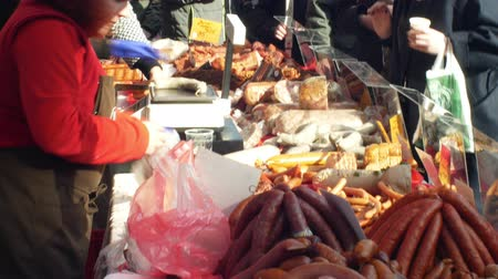 lardo : OLOMOUC, CZECH REPUBLIC, FEBRUARY 29, 2019: Marketplace with stall products pig slaughter traditional Czech household sausage, crowd of people shopping, sausage-meat, blood sausage