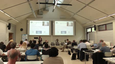 phd : CESKE BUDEJOVICE, CZECH REPUBLIC, SEPTEMBER 2, 2018: People scientists international science start listening to a lecture at a conference biotechnology presentation, teacher, students, teaching Stock Footage