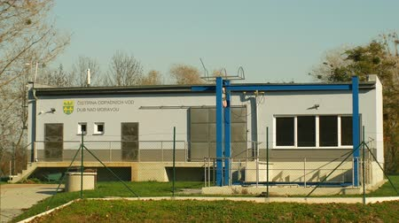 çevre kirliliği : OLOMOUC, CZECH REPUBLIC, OCTOBER 24, 2018: Waste water and wastewater treatment plant newly and new built processes sedimentation, filtration, oxidation, biochemical, healthy environment Stok Video
