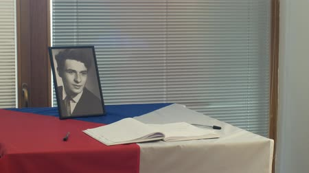 perseguição : OLOMOUC, CZECH REPUBLIC, JANUARY 16, 2019: Jan Palach portrait student and flag Czech Republic, city hall room and historic buildings in Olomouc, memorial book of the nations messages