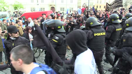 activist : BRNO, CZECH REPUBLIC, MAY 1, 2019: Conflict of radical extremists and activist man against radicalism, extremists. National Social Front. Police and policeman helmet riot intervene and suppress fight