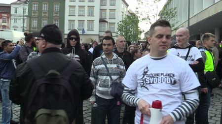 мегафон : BRNO, CZECH REPUBLIC, MAY 1, 2019: Erik Lamprecht, head of the National Social Front Czech, is forming a procession crowd and a gathering for a march with a megaphone. March of radical extremists