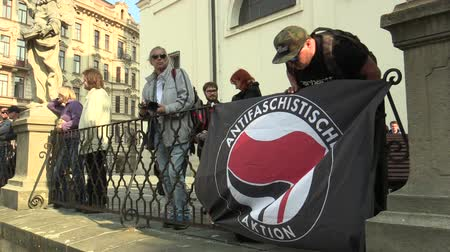 přímý : BRNO, CZECH REPUBLIC, MAY 1, 2019: Antifaschistische Aktion Flag of Antifa Antifascists at the event against the National Social Front and the Workers Party of Social Justice Czech Republic