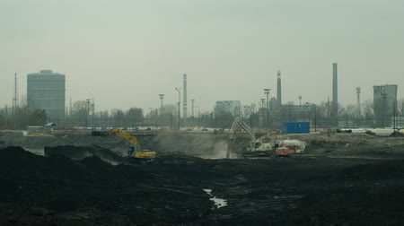 liquidazione : OSTRAVA, CZECH REPUBLIC, NOVEMBER 28, 2018: Liquidation of remediation of landfills waste of oil and toxic substances, burnt lime is applied to the oil by means of fine excavator, smog calamity