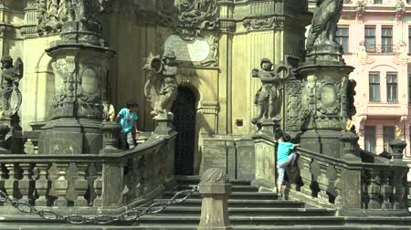 namesti : OLOMOUC, CZECH REPUBLIC, SEPTEMBER 1, 2018: UNESCO heritage plague column, gypsies and gypsy children prohibited and illegal entry of people to the memory landmark of architecture, city Olomouc
