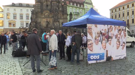 depliant : OLOMOUC, CZECH REPUBLIC, SEPTEMBER 2, 2018: The pre-election meeting of the Civic Democratic Party of ODS on square, people receive free-of-charge wine and sweets, discussing politics, policy election