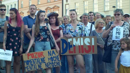 коммунизм : PRAGUE, CZECH REPUBLIC, JUNE 11, 2019: Demonstration of people crowd against Prime Minister Andrej Babis, banner with demission and resignation and second for the currently ill and mentally ill,