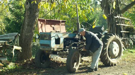 período : OLOMOUC, CZECH REPUBLIC, OCTOBER 24, 2018: Tractor stark historical home made, 60 years old, farmers in the village are home-made, old man carries out the test and engine start test