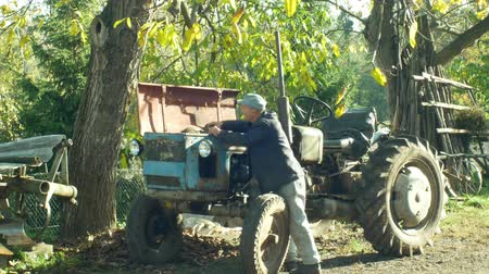 legendary : OLOMOUC, CZECH REPUBLIC, OCTOBER 24, 2018: Tractor stark historical home made, 60 years old, farmers in the village are home-made, old man carries out the test and engine start test