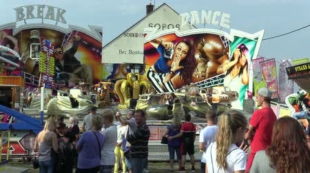 multifunctional : OLOMOUC, CZECH REPUBLIC, AUGUST 30, 2018: Carousel space ship multifunctional fun and attraction modern tempting, people are happy and rejoice, swings amusement park Stock Footage
