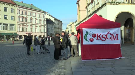 depliant : OLOMOUC, CZECH REPUBLIC, SEPTEMBER 2, 2018: Pre-election stand in square of the Communist Party of Bohemia and Moravia KSCM, people receive sweets, balloons and leaflets, authentic, policy election