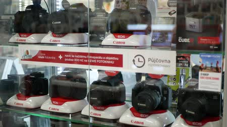 professional photography : PRAGUE, CZECH REPUBLIC, MAY 25, 2019: Photographic and video technology professional and modern cameras lenses, accessories in luxury glass cabinets in business house and shop