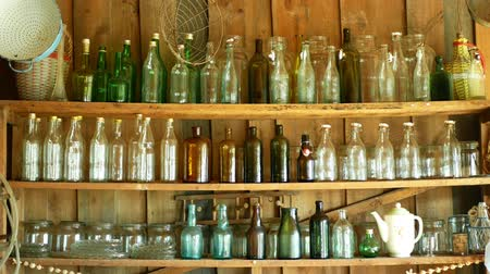 Česká republika : Jar bottles with glass and carboy, traditional Moravia cottage old folk Hana. Interior of peasant and dishes glassful hut, farmhouse, house articles furniture crockery or tumblerful punch things