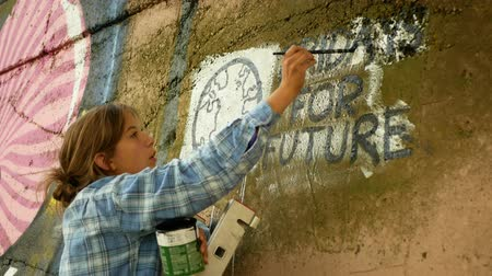 initiator : OLOMOUC, CZECH REPUBLIC, SEPTEMBER 22, 2019: Friday for future wall painting Marie Zatloukalova organizer in Olomouc, action Extinction Rebellion demonstration