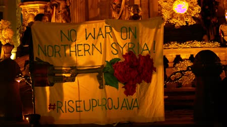 político : PRAGUE, CZECH REPUBLIC, OCTOBER 17, 2019: Kurdish people demonstration against Turkey and President Recep Tayyip Erdogan, banner flag sign No war on Northern Syria rise up 4 Rojava, activists