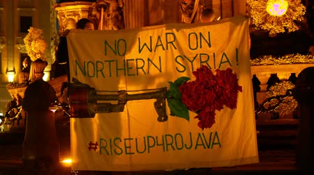 PRAGUE, CZECH REPUBLIC, OCTOBER 17, 2019: Kurdish people demonstration against Turkey and President Recep Tayyip Erdogan, banner flag sign No war on Northern Syria rise up 4 Rojava, activists