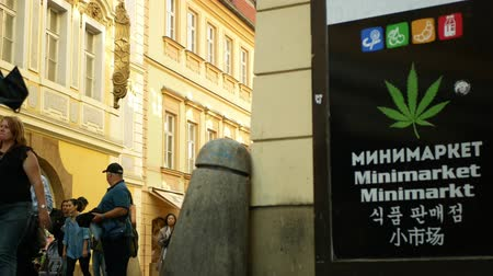 PRAGUE, CZECH REPUBLIC, SEPTEMBER 9, 2019: Shop hemp cannabis medical, also sells seeds products, addicted people use drugs, storefront display shop with cannabis symbols leaf, people Wideo