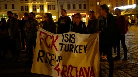 PRAGUE, CZECH REPUBLIC, OCTOBER 17, 2019: Kurdish people demonstration against Turkey and President Recep Tayyip Erdogan, banner flag sign Fck Isis Turkey rise up 4 Rojava, activists