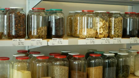 frasco pequeno : Shop without packaging, healthy nutrition wide assortment of cereals, legumes, dried fruits, nuts, flour in jars and glass bottles on their own bags, without packaging store, raw materials
