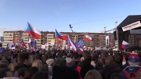 know : PRAGUE, CZECH REPUBLIC, NOVEMBER 16, 2019: Demonstration of people crowd against Prime Minister Andrej Babis demise, 300,000 mass protesters crowd throng of activists Letna Prague, flags and banners Stock Footage