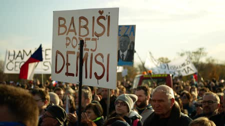 csehország : PRAGUE, CZECH REPUBLIC, NOVEMBER 16, 2019: Demonstration of people crowd, banner Babis resign demission, throng of activists Letna Prague Czech Republic, 300 000 mass protesters
