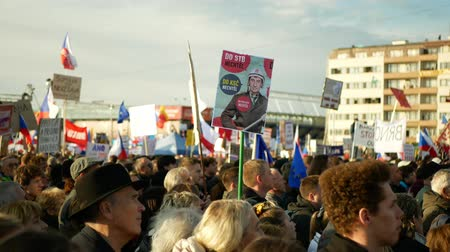 tél : PRAGUE, CZECH REPUBLIC, NOVEMBER 16, 2019: Demonstration of people crowd, banner Andrej Babis did not want to the STB and the Communist Party, throng of activists Letna Prague, flags