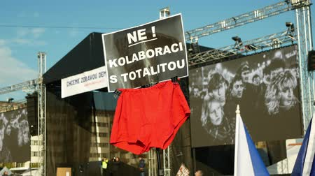 onderbroek : PRAGUE, CZECH REPUBLIC, NOVEMBER 16, 2019: Demonstration of people crowd, banner not collaboration with totalitarian red underpants, throng of activists Letna Prague Czech Republic